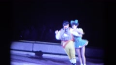 1969: man and women ice skaters dressed in costume performing FORT WAYNE, Stock Footage