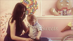 Mom and year-old son in the nursery. Mother's love. A happy family. Stock Footage