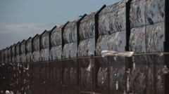 Plastic trash bags on the fence of recycling garbage lot Stock Footage