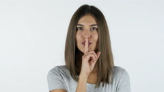 Gesture of silence, Finger on Lips by Beautiful Girl, White Background in Studio Stock Footage