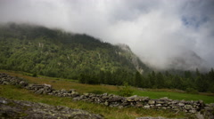 Motion timelapse of a alpine meadow with fog Stock Footage