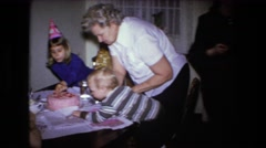 1973: birthday party for little blonde boy with pink cake FORT WAYNE, INDIANA Stock Footage