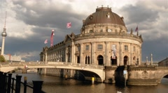 Pan establishing shot of Bode Museum on Museum Island with TV Tower in Berlin Stock Footage