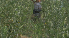 Tiller close up, gardener plowing soil at plants plantation by Cutter. Stock Footage