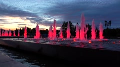 Modern red lit park fountains at night. Architectural LED lighting. 4K shot Stock Footage