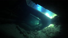 Dark corridor of shipwreck with vibrating sunlight - Umbria, Sudan Stock Footage