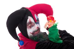 Jester with a hand puppet, isolated on white Stock Photos