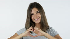 Heart Shape by Hands by Beautiful Girl, White Background in Studio Stock Footage