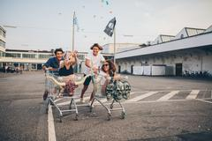 Young friends having fun on a shopping trolleys Stock Photos