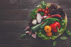 Plenty of fresh vegetables on wooden background with copy space Stock Photos