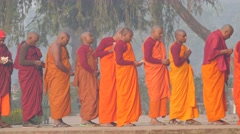 Lined up monks with money offerings,Kushinagar,India Stock Footage