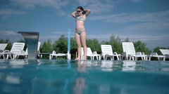 Happy Active Girl Jumping and Diving in Swimming Pool -Slow Motion Underwater Stock Footage