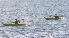 People going in kayaks on the sea Stock Footage
