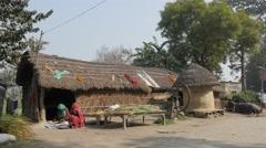 Farmers at village hut,Kushinagar,India Stock Footage