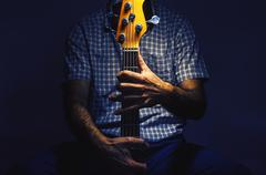 Bass Player and His Guitar Stock Photos