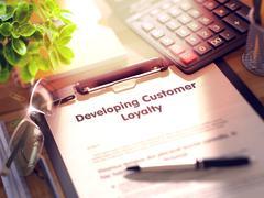 Developing Customer Loyalty - Text on Clipboard. 3D Illustration Stock Illustration