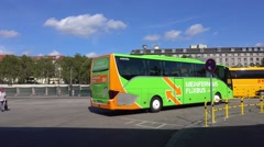 Long distance coach Flixbus at bus stop Stock Footage