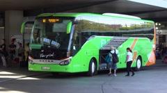 Long distance coach Flixbus at bus stop Stock Footage