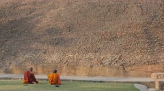 Monks sitting at cremation stupa,Kushinagar,India Stock Footage