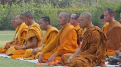 Monks meditating at cremation stupa,Kushinagar,India Stock Footage