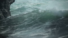Powerful ocean waves crashing on rocky coastal cliffs close up Stock Footage