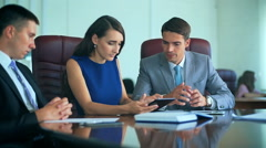 Professional workers and boss meeting and discussing topics with tablet Stock Footage