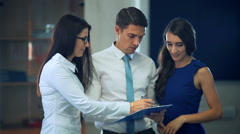 A business team in office planning work Stock Footage