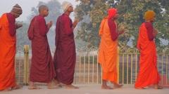 Monks circling Parinirvana temple,Kushinagar,India Stock Footage