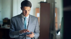 Young businessman with tablet in the office Stock Footage