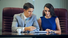 Discussing business. Two cheerful business people in casual wear talking and Stock Footage