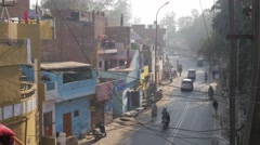 Colored houses along road with traffic,Lucknow,India Stock Footage