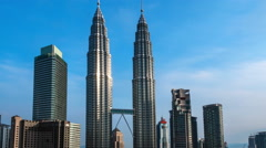 Clouds moving fast over famous Petronas Towers in downtown of Kuala Lumpur Stock Footage