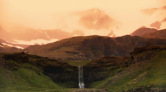 Icelandic mountain waterfall landscape   fantasy land artistic sunrise Stock Footage