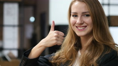 Thumbs Up by Beautiful Girl Sitting Indoor, Portrait Stock Footage