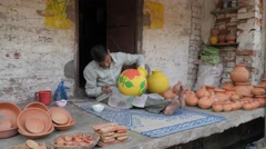 Man painting pottery,Lucknow,India Stock Footage