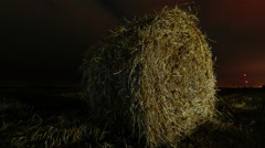 Hay roll on the field at night Stock Footage