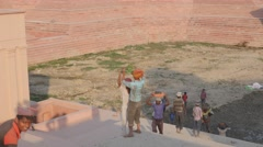 Construction worker lifting sand from step well,Lucknow,India Stock Footage