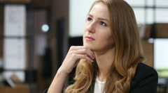 Thinking, Pensive Beautiful Girl Sitting Indoor Stock Footage