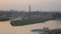 Small boat in river and skyline,Lucknow,India Stock Footage