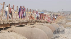 Pilgrims walking over bridge,Allahabad,Kumbh Mela,India Stock Footage