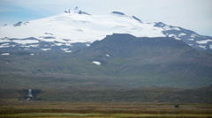 Snaefellsjokull glacier towering over waterfall valley Iceland summer Stock Footage
