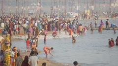 Pilgrims bathing in holy river at Sangam,Allahabad,Kumbh Mela,India Stock Footage