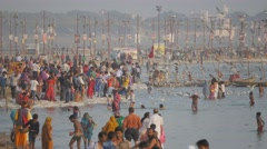 Pilgrims bathing in holy river with birds at Sangam,Allahabad,Kumbh Mela,India Stock Footage