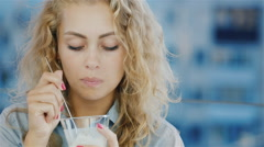 Portrait of a Young business woman eating ice cream in a cafe on the terrace Stock Footage