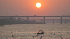 Rowing boat and bridge at Sangam at sunset,Allahabad,Kumbh Mela,India Stock Footage