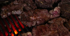 Cooking barbecue steak on the hot grill Stock Footage