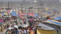 Crowds walking around Sangam with stalls,Allahabad,Kumbh Mela,India Stock Footage