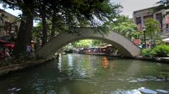 San Antonio riverwalk view going under bridge on sunny day 9 Stock Footage