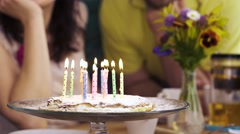 Unrecognizable people blow out candles on the birthday homemade pie 4K Stock Footage