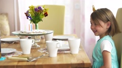 Little girl really wants to eat a festive homemade cake. She with pleasure licks Stock Footage